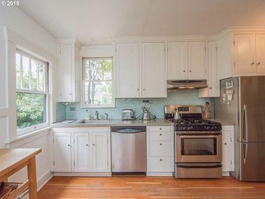 kitchen interior wood floors stainless steel appliances