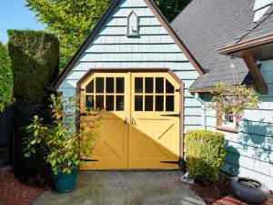 garage double doors yellow paint blue paint