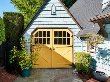 garage double doors yellow paint blue paint