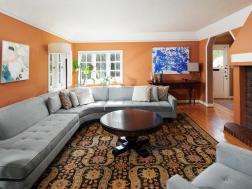 Living room interior windows wood floor brick fireplace