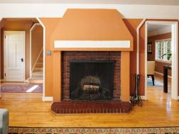 fireplace brick wood floor arched entryway
