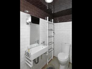 bathroom with tile walls on lower level of house with sink