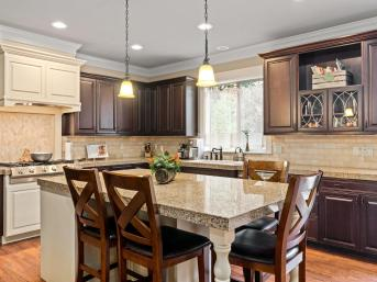 Kitchen with granite tile island and counters