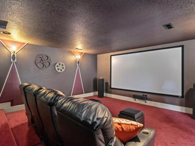 Entertainment room home theater with large screen
