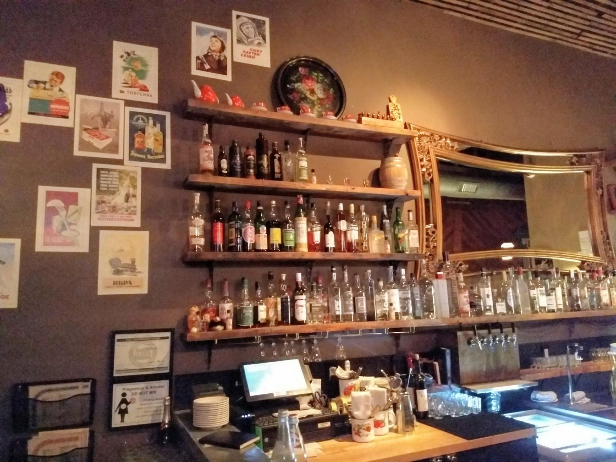 bar with bottles and a mirror at Kachinka