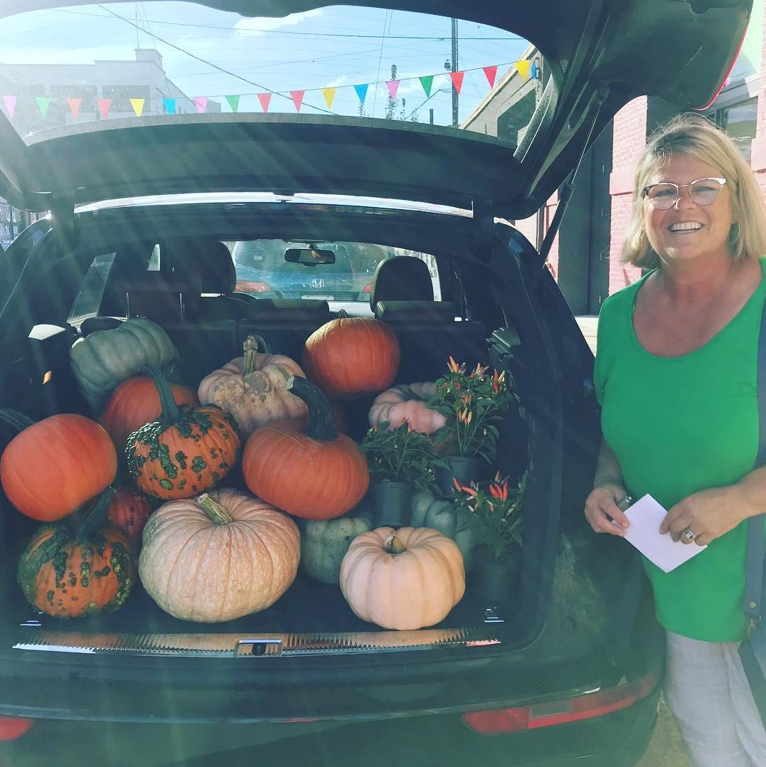 Car full of pumpkins with Susie Hunt Moran