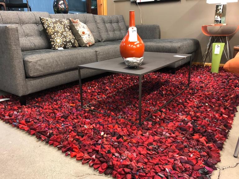 Red floor rug made of bowties