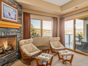 bedroom with fireplace and views of Columbia River