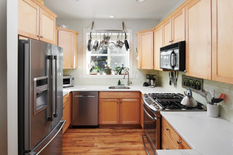 Kitchen with stainless steel appliances and hardwood floors