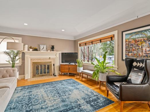 Living room wood floors picture window fireplace