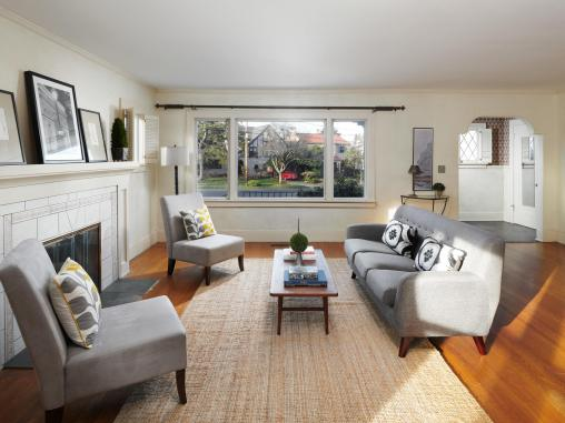 Living room interior hardwood floors and fireplace with furniture and window