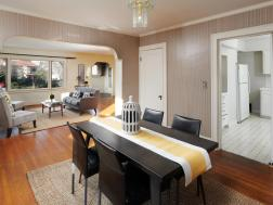 Dining room with table and living room and kitchen interior
