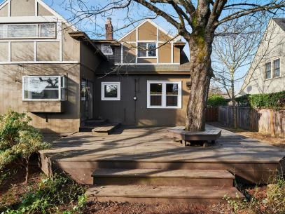 Deck home exterior with tree