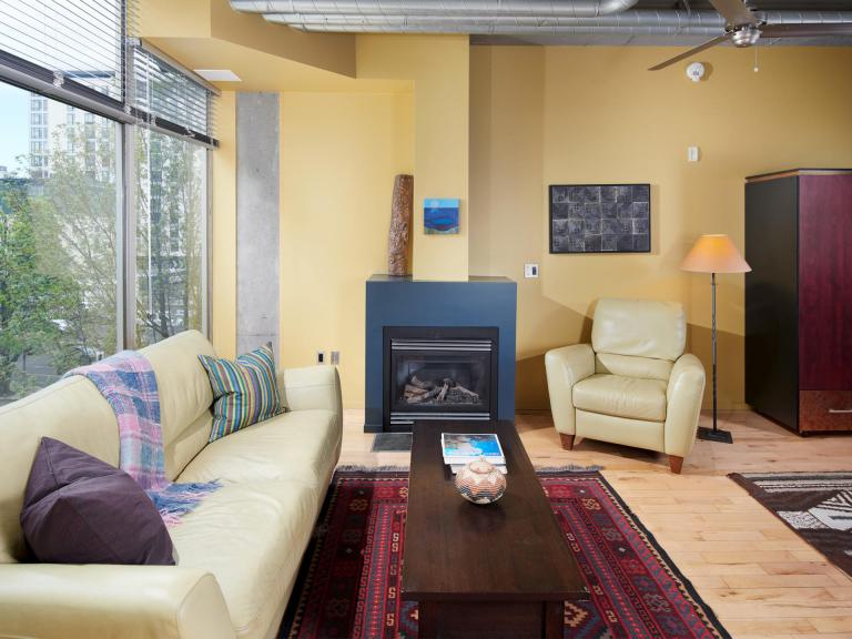 Interior Mosaic condo for sale downtown PDX floor to ceiling windows and fireplace