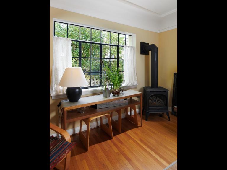 Living room w/ gas stove.