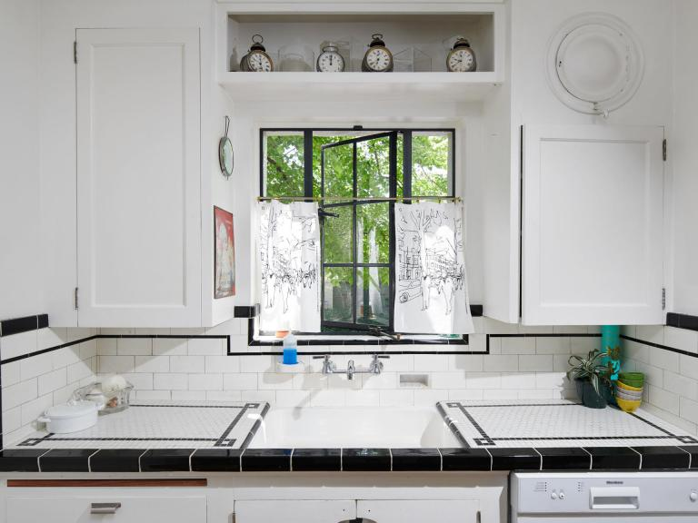 Newly remodeled kitchen w/ SSconvection oven w/ induction range + SS refrigerator.