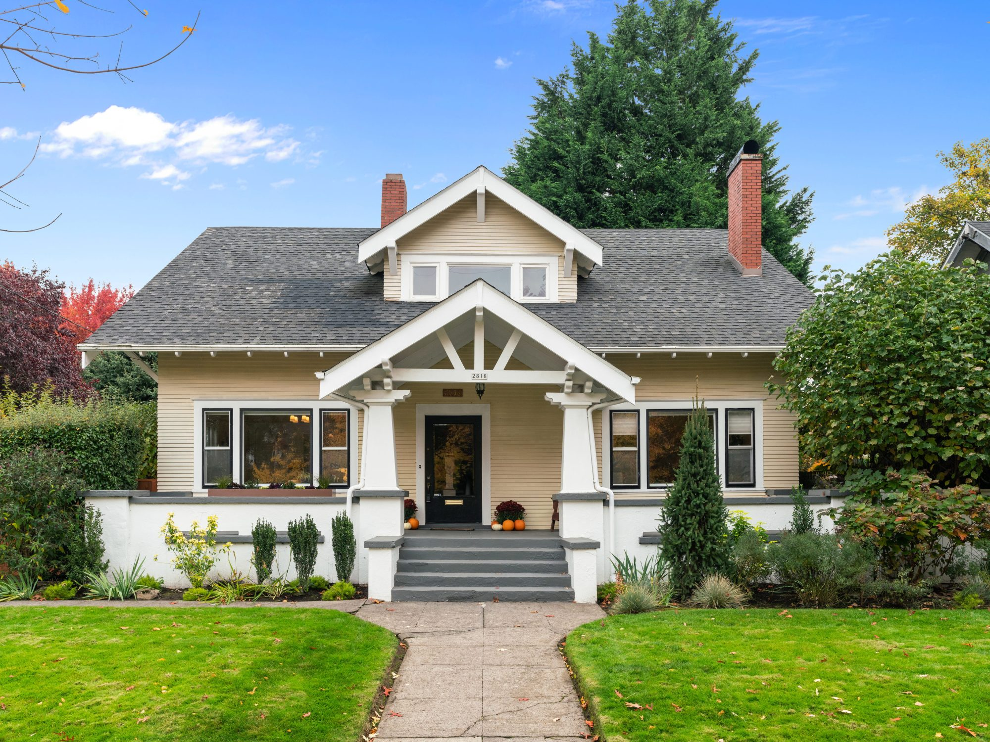 Irvington Craftsman home exterior in Northeast Portland with large porch and bright green grass