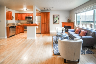 interior of condo in st johns portland with kitchen, fireplace and couch