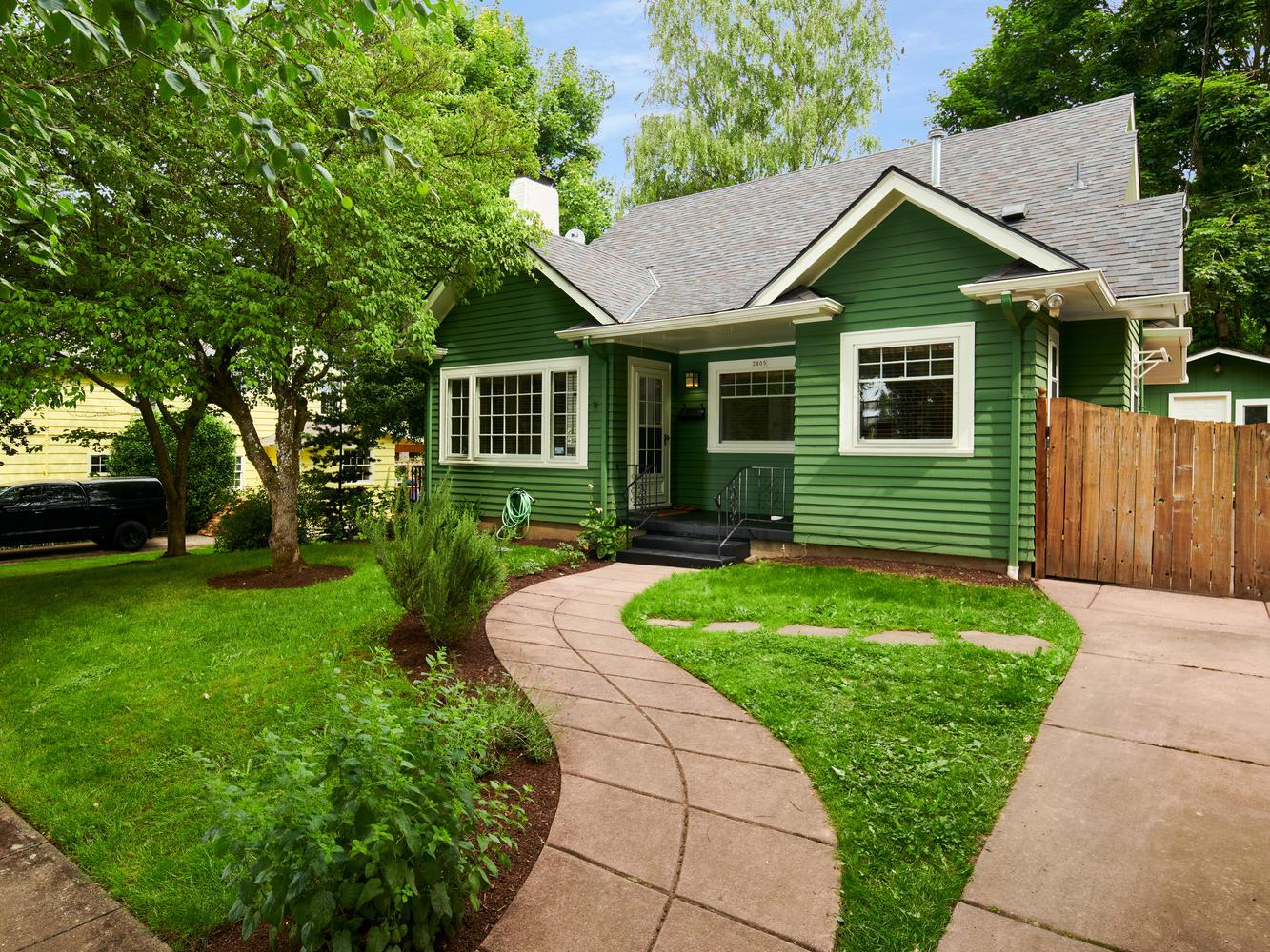Exterior of Craftsman home in Eastmoreland Portland, green grass, walkway to front door