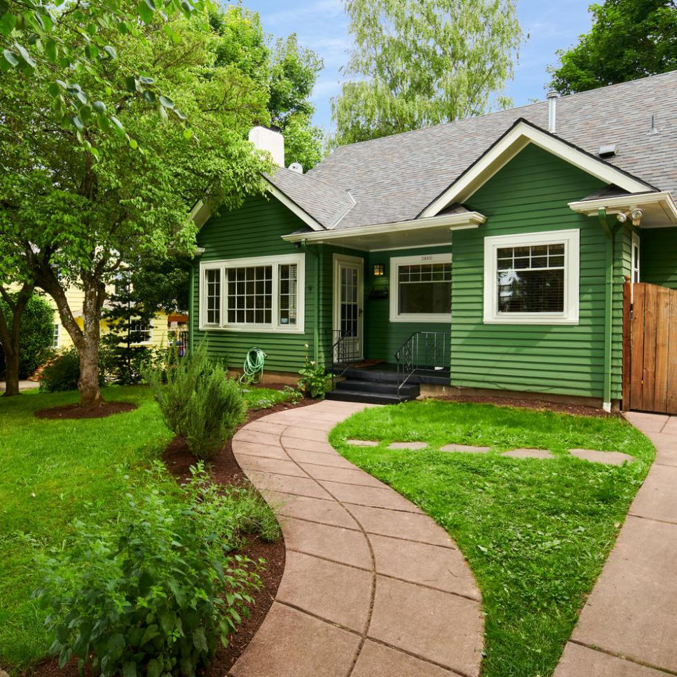 Exterior of Craftsman home in Eastmoreland Portland, green grass, walkway to front door